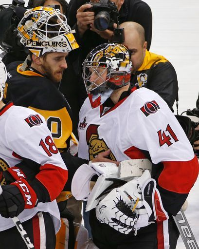 Pittsburgh Penguins goalie Matt Murray, left, and Ottawa Senators goalie Craig Anderson (41) meet in the handshake line following a 3-2 Penguins win in the second overtime period of Game 7 of the Eastern Conference final in the NHL Stanley Cup hockey playoffs in Pittsburgh, Friday, May 26, 2017. The Penguins won in double overtime 3-2 to advance to the Stanley Cup Finals. (AP Photo/Gene J. Puskar)
