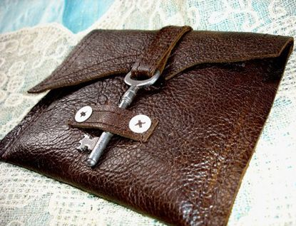 redo an old leather pipe bag into a clutch with a skeleton key latch. awesome!! no tutorial, just creativity