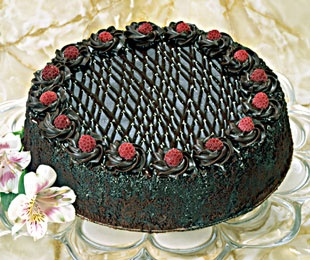 Dark bittersweet chocolate and raspberry await in every bite of this cake. Genuine Chambord liquer infuses both the chocolate sponge cake and the fudgy chocolate ganache icing, creating a harmony of raspberry and chocolate flavors you won't find in other cakes.