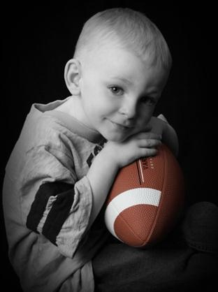 Kid with a rugby ball