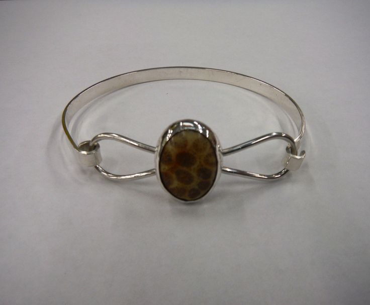 Fossilized coral bracelet/bangle by Christine Edwards