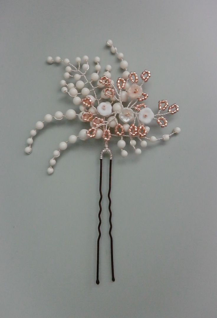 Pretty statement hair pin made from Swarovski glass pearls in Ivory, tiny glass flowers and Miyuki Delica seed beads in soft gold  Design: Winter Rose in Pale Gold with silver wire