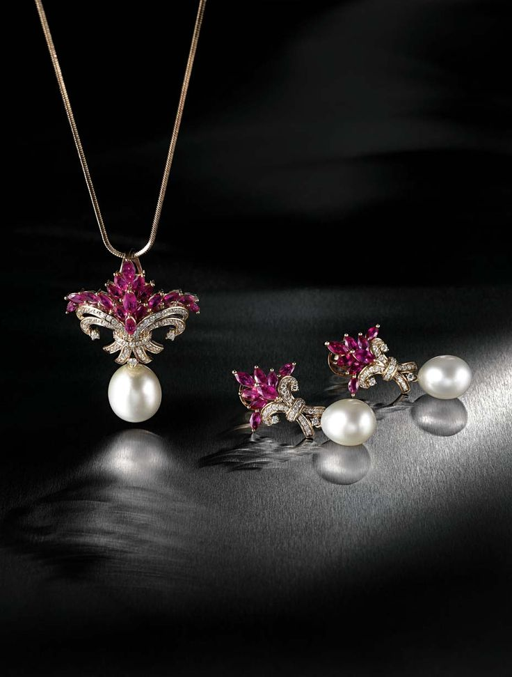 Farah Khan for Tanishq ruby pendant with a South Sea pearl drop accented with diamonds set in yellow gold alongside matching ruby earrings.: