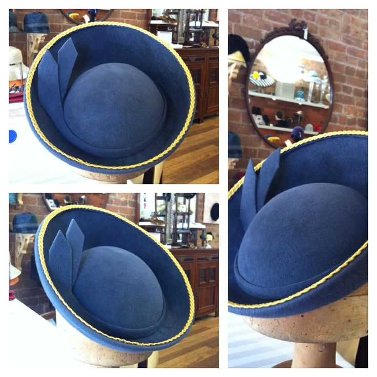 Grey fur felt block on coche block and upturned brim. Wired and rolled brim
