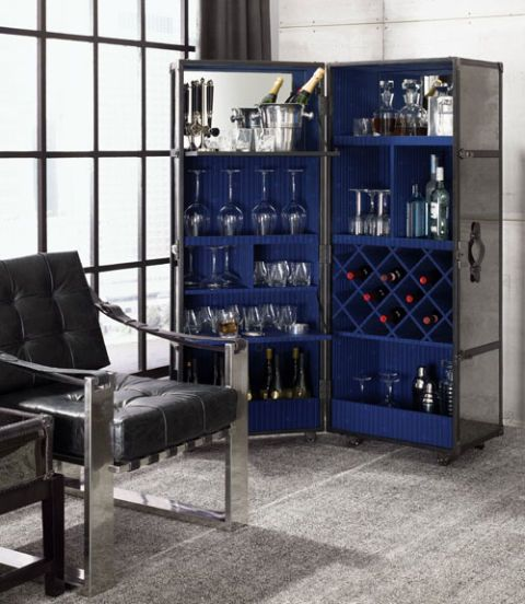 The Esquire man is a craftsman behind the bar, and he deserves an elegant place to store his tools — like this steel trunk with designated compartments for liquor, wine, glasses, and tumblers. $5,995