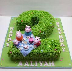 Vanilla sponge birthday cake with buttercream grass and Peppa pig picnic :o)