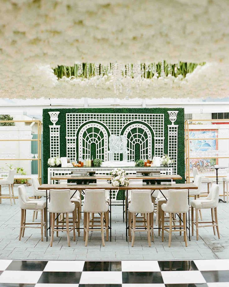 An Epic New Orleans Wedding with Classic Touches | Martha Stewart Weddings - Valerie Gernhauser of Sapphire Events conceived and designed the inverted garden of tulips, which honored Haylie's Dutch grandmother. The 24,000 cut flowers, shipped from Holland, were hung individually from a metal frame, a process that took nine hours. The checkered dance floor echoed the black-and-white marble floor at St. Louis Cathedral.