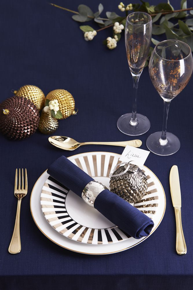 Combine soft shades of gold, bronze and pewter with deep navy blue for a luxurious and sophisticated look. Team Art Deco-inspired china with gold cutlery and use decorative pewter baubles to make interesting place card holders. Photography: Dan Duchars. housebeautiful.co.uk