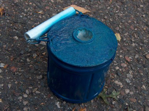 * Portable Flag Pole Stand (using plastic coffee can, cement, and pvc pipe)
