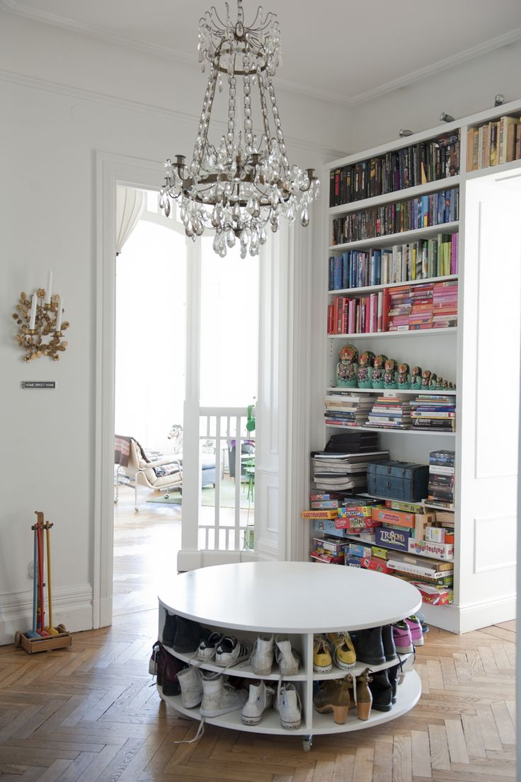 love the chandelier and you could put a pouf on top of the shoe table