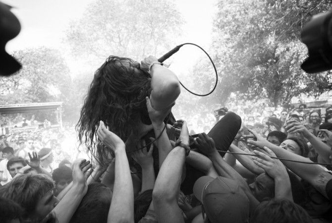 Pictured is Trash Talk frontman Lee Spielman crowdsurfing at the 2013 Pitchfork Music Festival in Chicago, IL. See http://pitchforkmusicfestival.com for a complete wrap. Photo by: Jason Bergman