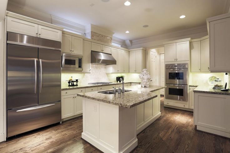 Wonderful gourmet kitchen!! Built in Kitchen Aide double door refrigerator, Double Viking ovens, Viking Microwave, Viking  Dishwasher &  5 burner Viking Cook Top with granite counters and stone back splash. Large island has space as a breakfast bar.