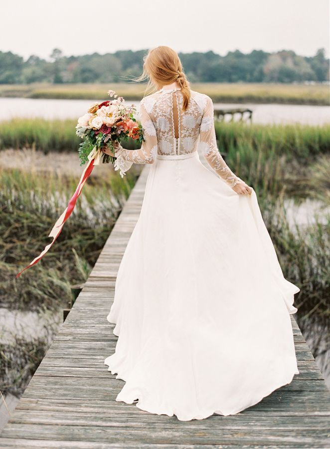 Rustic + bohemian sheer lace long sleeve wedding dress: http://www.stylemepretty.com/2016/02/16/rustic-elegant-wedding-inspiration-at-river-oaks/ | Photography: Lauren Peele - http://www.laurenpeelephotography.com/