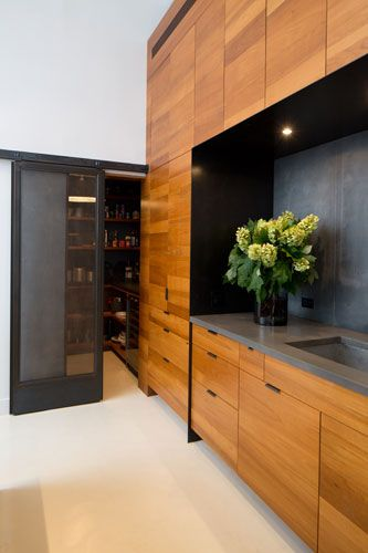 Union Square Loft, by Studio. Simple lines in the kitchen and I like the pantry doors.I like the timber