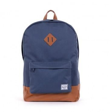 """The Heritage has Herschel's signature look and feel and includes rubber detailing.   - Fully Lined With Our Signature Coated Poly Fabric - Up To 15"""" Laptop Sleeve Pocket - Single Front Pocket With Key Clip - Internal Media Pocket  Measurements Height: 18in / 46cm Length: 12in / 30.5cm Depth: 5.5in / 14cm"""
