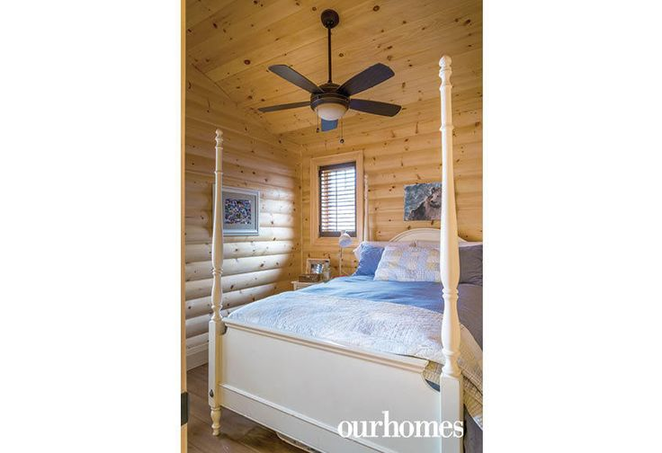 """A four-poster queen bed dressed in calming bed linens.    See more of this home in """"Fifth Generation Legacy on Muskoka's Moon River"""" from OUR HOMES Muskoka Early Summer 2017: http://www.ourhomes.ca/articles/build/article/fifth-generation-legacy-on-muskokas-moon-river"""