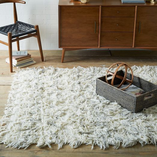 Our Chevron Wool Rug is lightly textured, for a look that's more measured than traditional shag rugs. Handwoven from soft New Zealand wool, it makes a nice addition to the bedroom or living room.