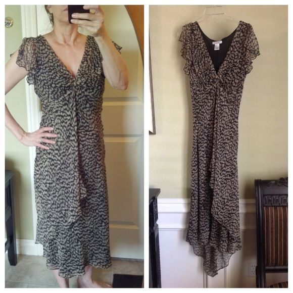 Chiffon tea length dress Gorgeous gorgeous gorgeous!  Excellent condition!  This 100% silk dress has an animal print design.  The hemline is beautiful as it is a little longer and comes to a point in back.  It is fully lined and has pullover styling.  The little sleeves are split.  Super lightweight and just floats around the body!  Only worn once.  The tag says 8, but I'm a 6 and it it fits me fine...not too big.  Purchased at a little boutique in San Clemente, CA. Redux Dresses