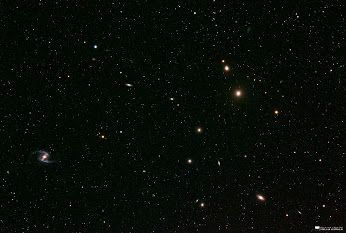 """""""The Fornax Galaxy Cluster"""" by Will Vrbasso. My humble attempt at imaging the fantastic Fornax Galaxy Cluster with my stock DSLR. Count the galaxies (most of them are round blobs, but the spiral at the bottom left is the pretty obvious galaxy IC1365)."""