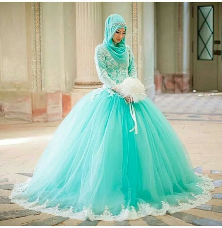 Gorgeous wedding dress , aqua color and a tulle skirt . the color is so unique and lovely simply amazing . / Hijab and dresses / a beautiful Muslim bride .