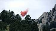 Colorado fires: Boulder breathes easier as rain falls