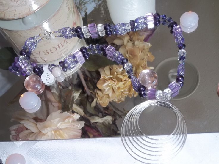 White gold plated pendant with purple necklace. Some of the beads were imported from China and are currently not available in Canada. Only Unique Designs by Amie has these beads