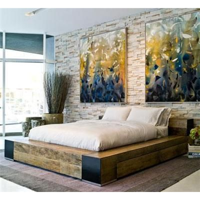Platform Bed with Open Windows, and a nice display of wall art for a New York penthouse feels.