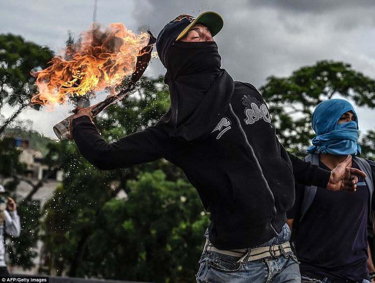 Demonstrators attempted to reach the headquarters of the country's electoral body yesterday by hurling Molotov cocktails and rock at riot police standing guard