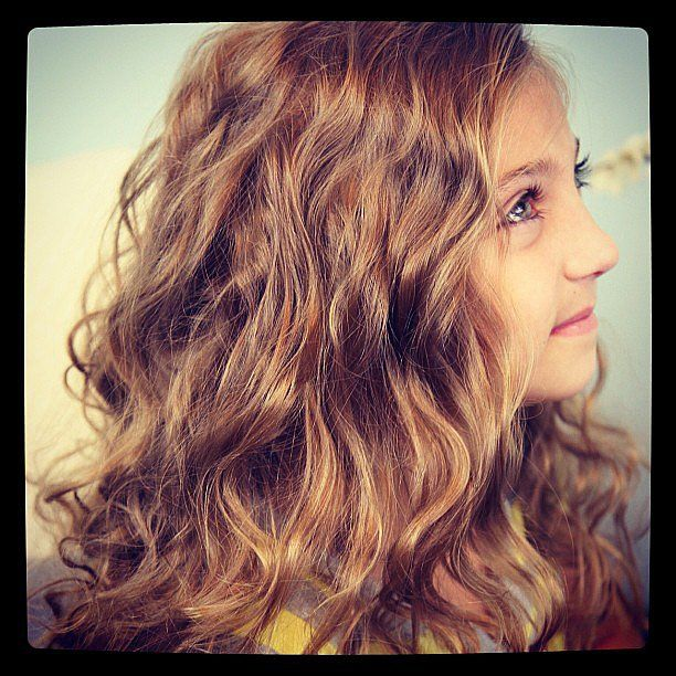 Want to give your girl some waves? Trade an iron for easy-to-make knots.   Source: Instagram user Cutegirlshairstyles