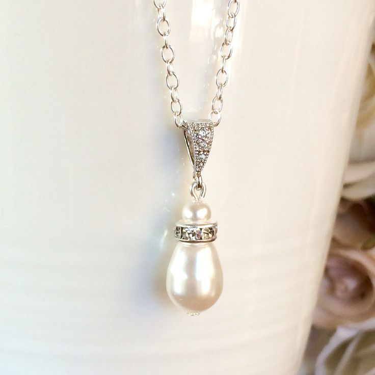 Sterling silver Swarovski teardrop pearl bridal necklace by Colour and Sparkle. Visit our Etsy store to view our collection of bridal jewellery and wedding jewellery