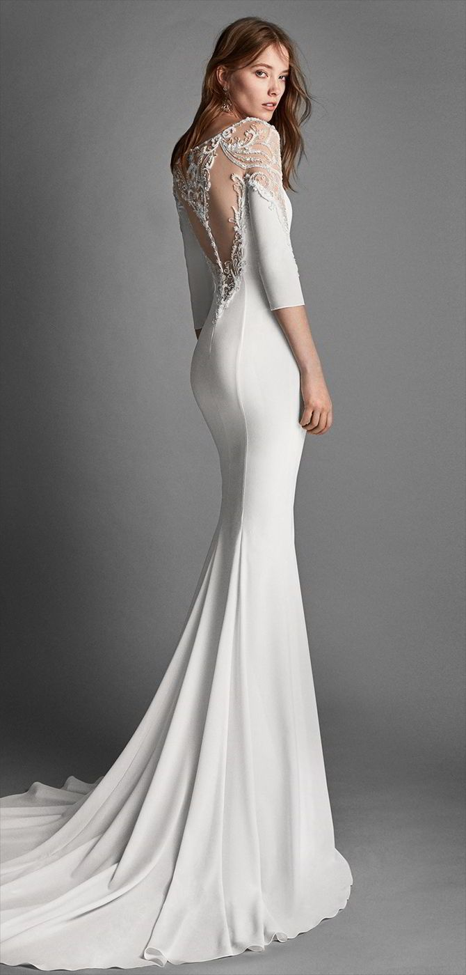 Alma Novia 2018 Mermaid-style crepe Georgette wedding dress with long sleeves and jewelled back.