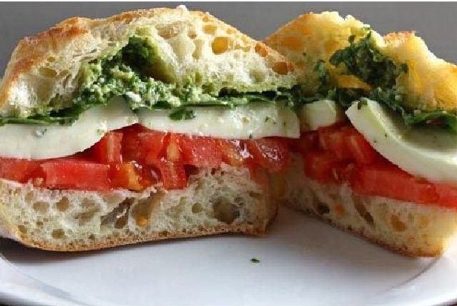 Meatless Monday: Caprese Sandwich | A caprese sandwich is a fresh meatless meal.  Homemade basil pesto is layered with fresh mozzarella cheese and thick slices of sweet tomatoes.  This sandwich is super simple but the flavors are bright and refreshing.  This dish can be on the table in just 10 minutes.- Foodista.com