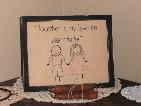 A cute couple holding hands standing side by side. This is hand stitched by me on coffee stained muslin and backed with warm and natural batting. The stitchery will come in an 8X10 simple handmade primitive looking wooden frame without glass , nothing fancy. It is painted black and ruffed with sand paper for an aged look. It will come with a saw tooth hanger and can be hung on the wall or propped upon a shelf.