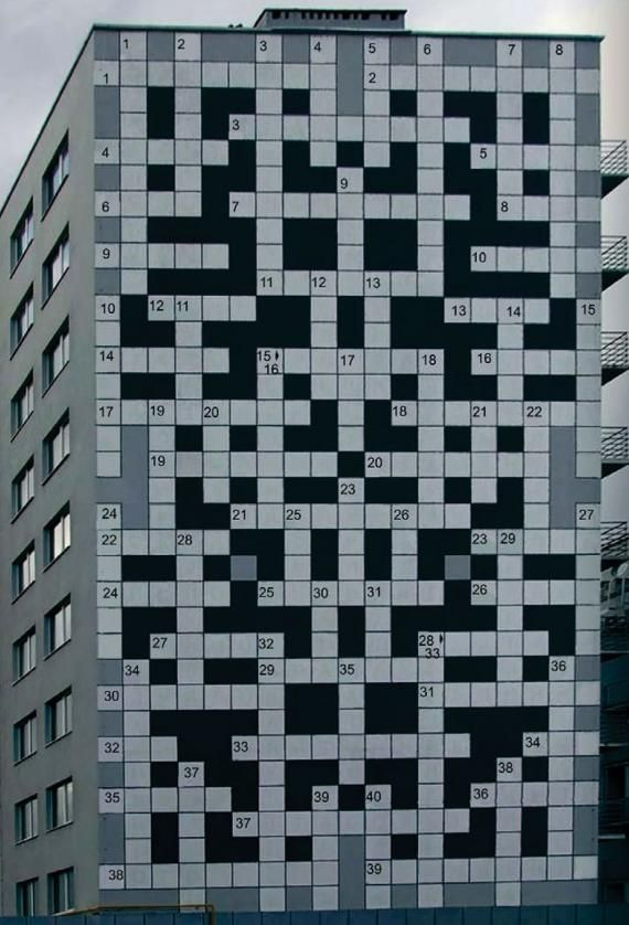 Crossword puzzle building in Lviv, Ukraine [street art]. You'll have to wait till nighttime, when the combination of the installed lighting system and the fluorescent paint fills up all the boxes with the correct answers.