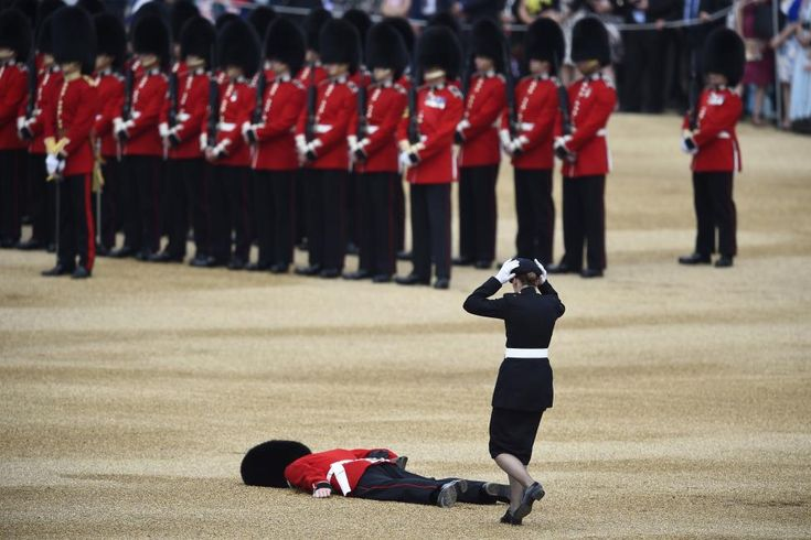 Reuters / Saturday, June 11, 2016 A Guardsman faints at Horseguards Parade for the annual Trooping the Colour ceremony in central London, Britain June 11, 2016. Trooping the Colour is a ceremony to honour Queen Elizabeth's official birthday. The Queen celebrates her 90th birthday this year. REUTERS/Dylan Martinez