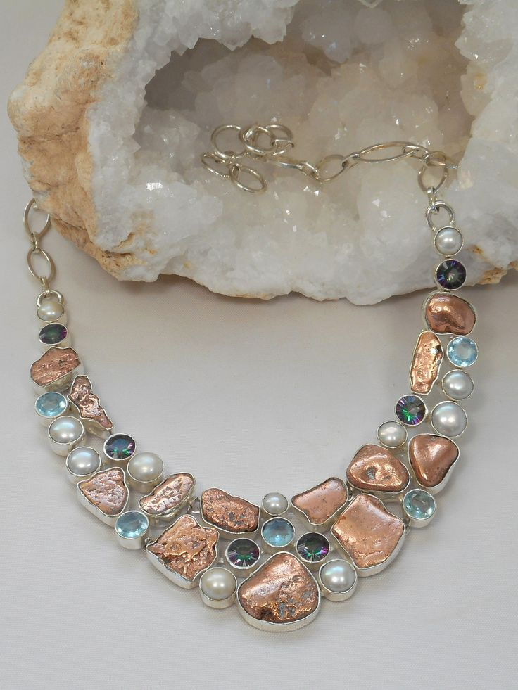 Andrea Jaye Collection Native Copper and Pearl Necklace with Blue Topaz -  Handmade Native Copper, Topaz and Pearl Gemstone Necklace, pairing 13 free-form Copper nuggets with 6 Rainbow Topaz gemstones, 5 Swiss Blue Topaz gemstones and 11 Pearls, set in 925-hallmarked sterling silver.
