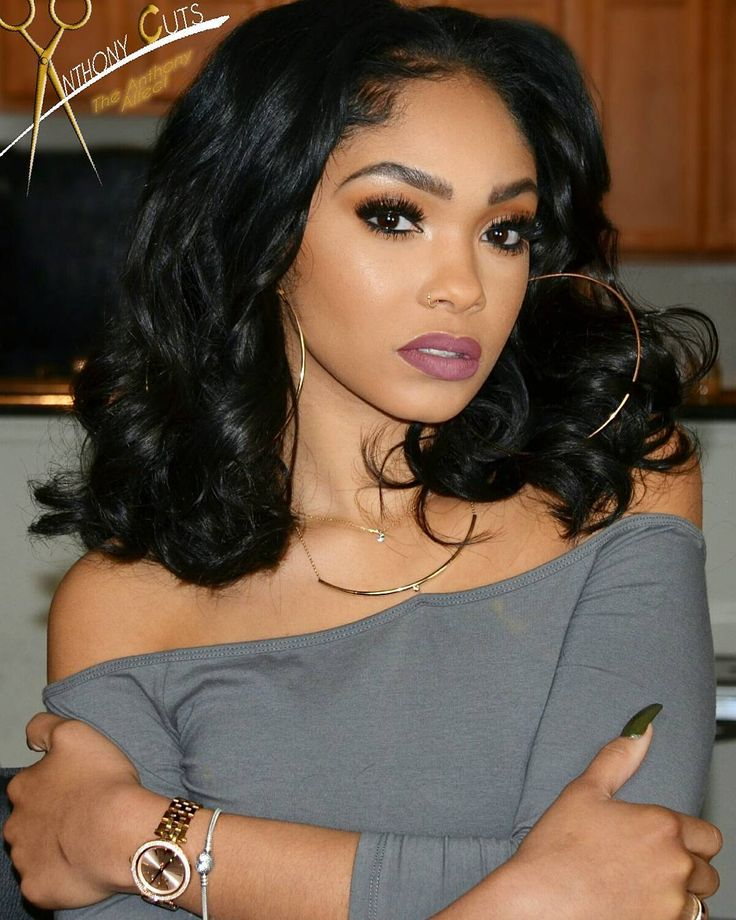 shoulder length black weave hairstyle