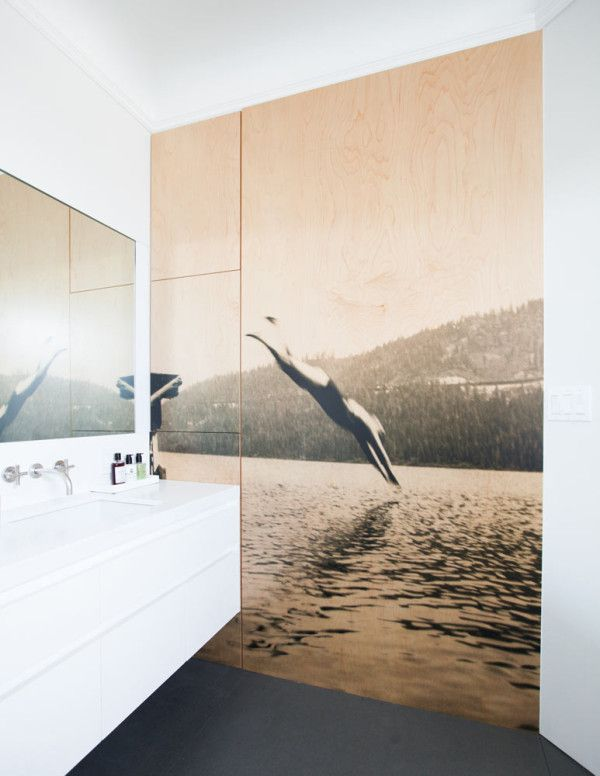photographic print overlay that covers cabinetry in the bathroom
