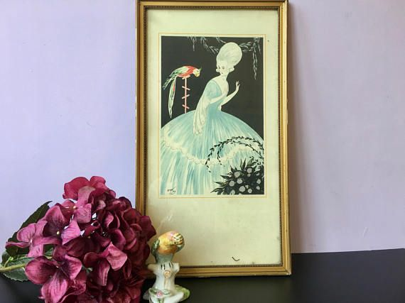 A romantic picture of a Lady of the court with a parrot. In original frame. A real delight for the eye! Signed in the plate Emon Dy. Printed in France. Measures with frame: 17.3 x 9.6 inches (44 x 24,5 cm). In very good vintage condition. Please do not hesitate to contact me for further information or pictures.  SHIPPING COSTS vary according to the destination and are not always exact based on the tarifs of the local postal service. In case you find them completely off, please contact me and…