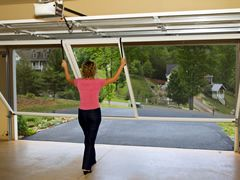 When it is not in use, your garage door screen rolls up neatly and hides inconspicuously into a customized cover, making it a truly retractable garage door screen
