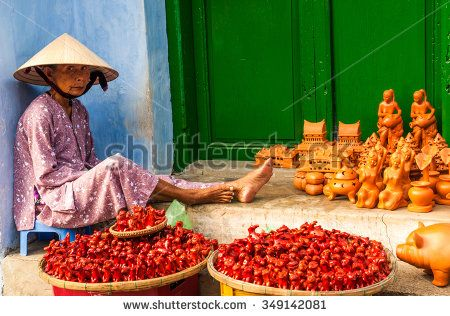 Hoi An, Central Vietnam,  Circa February 2013 . An unidentified vietnamese woman selling traditional clay toys in the Old Town