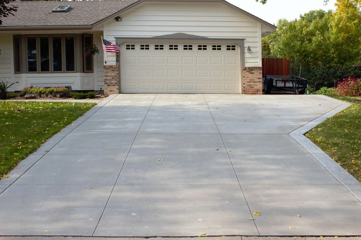 Gray Brushed Concrete Driveway with Decorative White ...