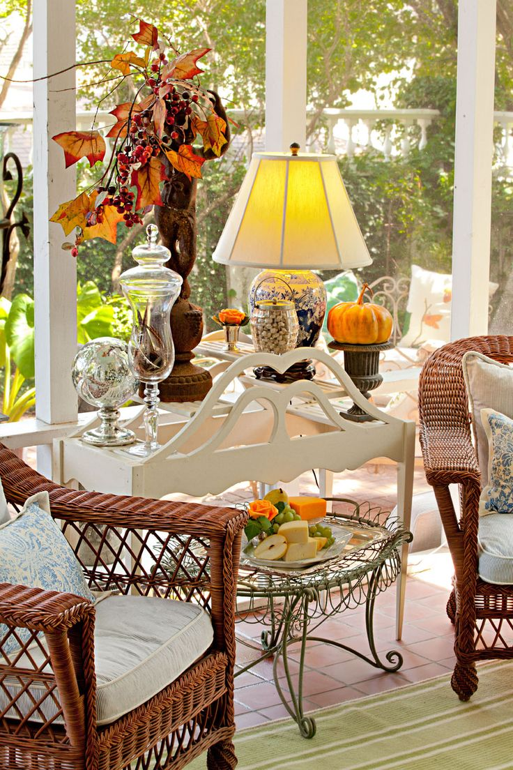 Nell Hill's Garden Room - Fall relaxing spot! Like the small wire table under the wooden one