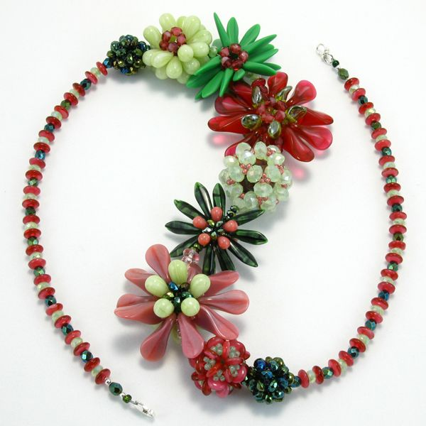 A wild garden statement necklace. A variety of Czech glass beads are created into beaded beads and then connected into a lyrical garden necklace. $198.00 #jewelry #necklace #handmadejewelry #statementjewelry #fashion