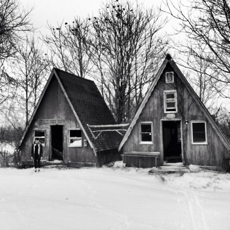 Two Abandoned A-frame Buildings From A Lost Ski Area In