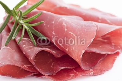 Bindenfleisch: Meat that is cured then dried in clear mountain air, retaining a fine flavour and bright color. Served very thinly sliced together with wholegrain bread and red wine. A specialty of the Grisons area.