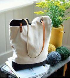 Essa bolsa de tecido é super moderna e fácil de fazer.