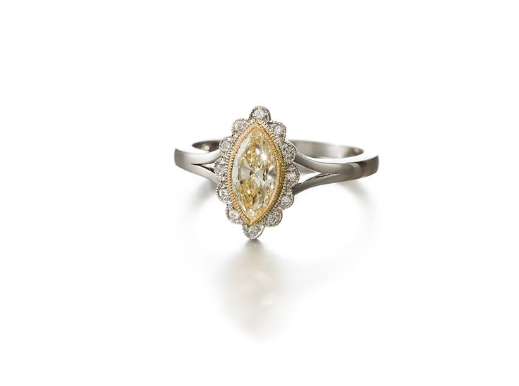 A Cluster Ring With Fancy Yellow Diamond