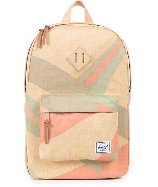 Make sure your travel needs are covered with the style of this Portal print backpack that features ample storage space with a padded laptop sleeve and zip closures for secure storage.