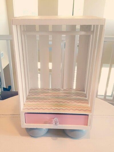 Next Generation doll closet diy. Made with a wooden crate. I just love how it turned out.